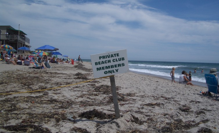 "This is an illegal sign. Yes it is private property, but we have the right to use the first ten feet nearest the water for our ""shore privileges."""
